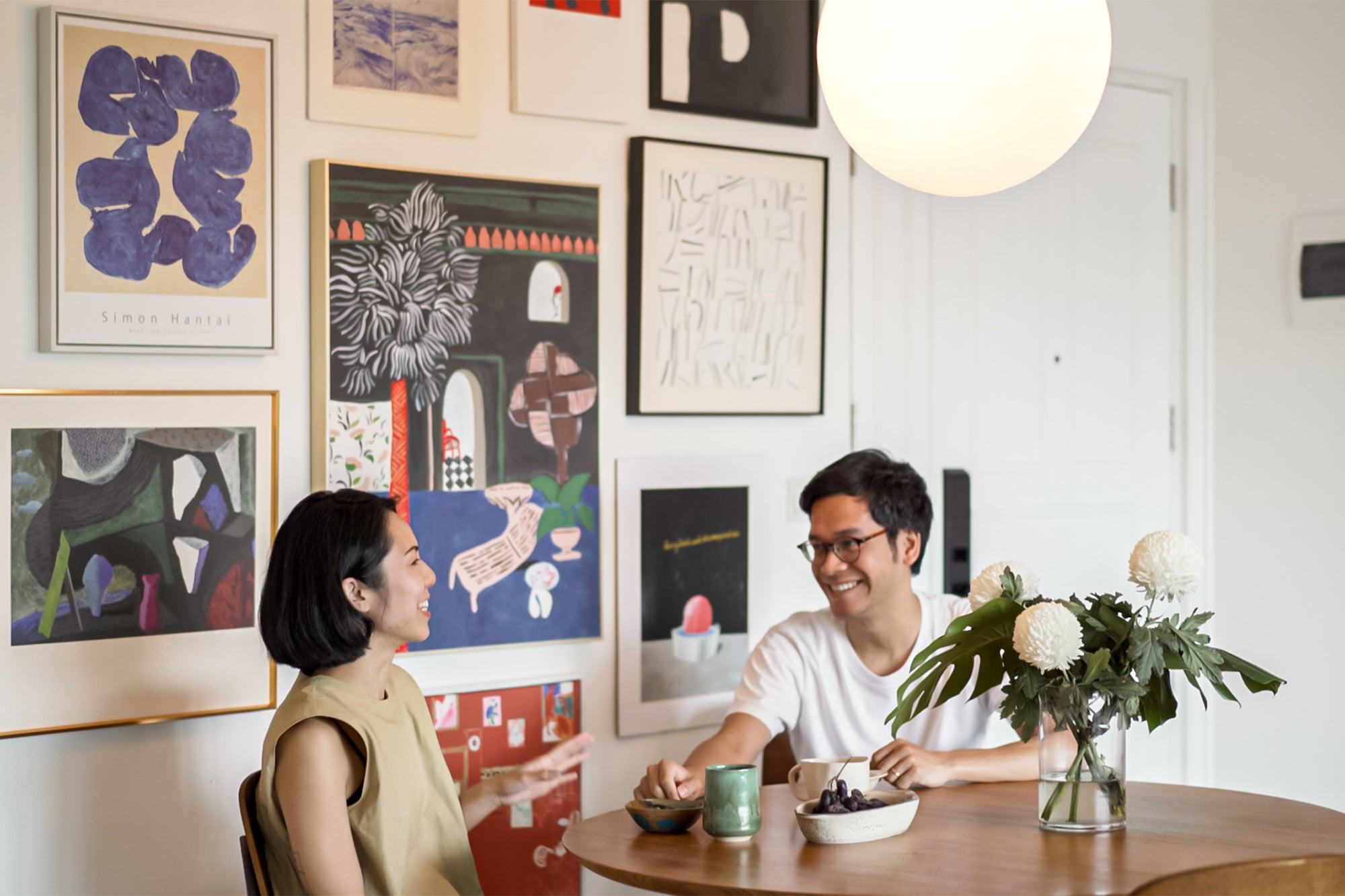 couple having a meal in art-filled home