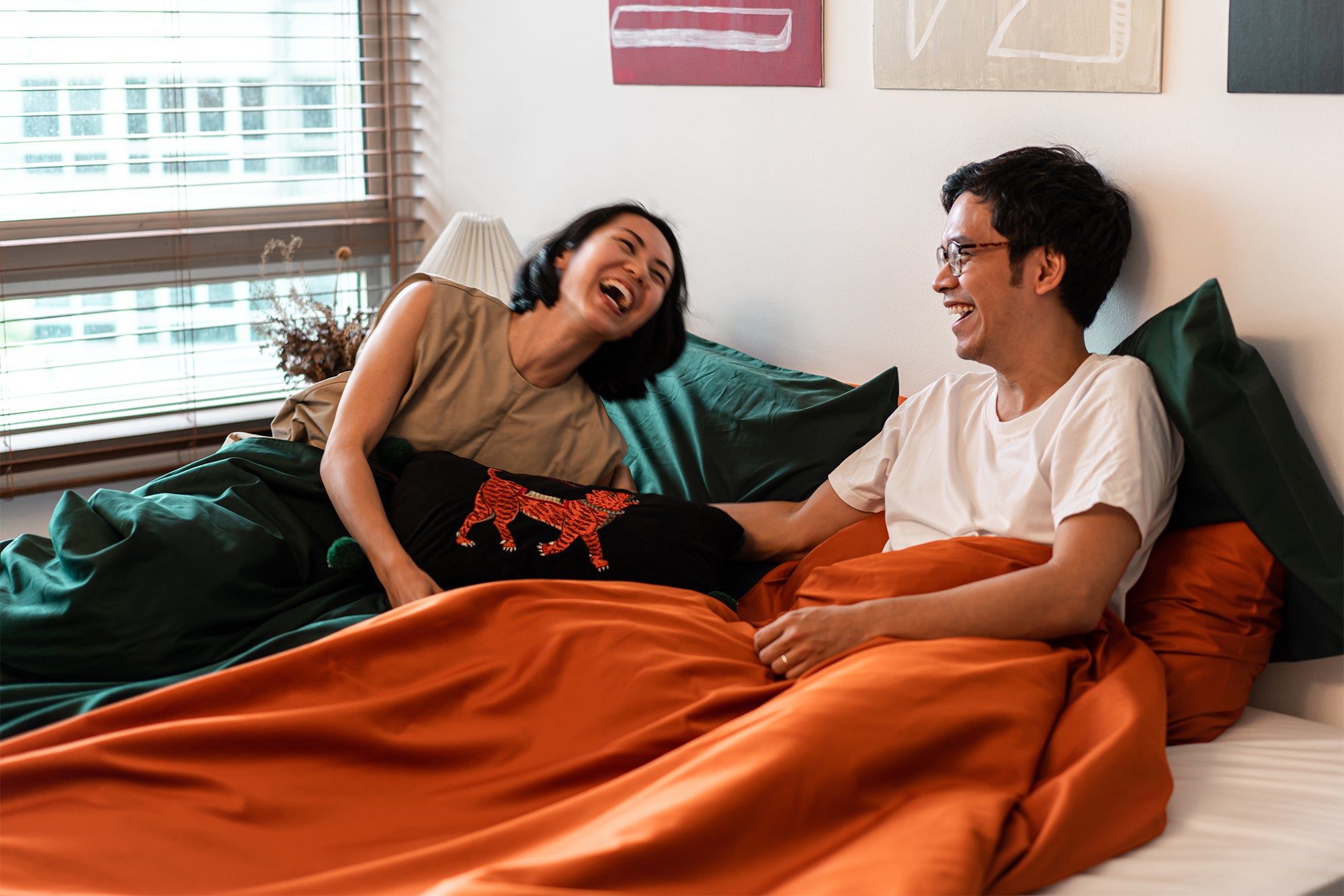 couple laughing in bedroom