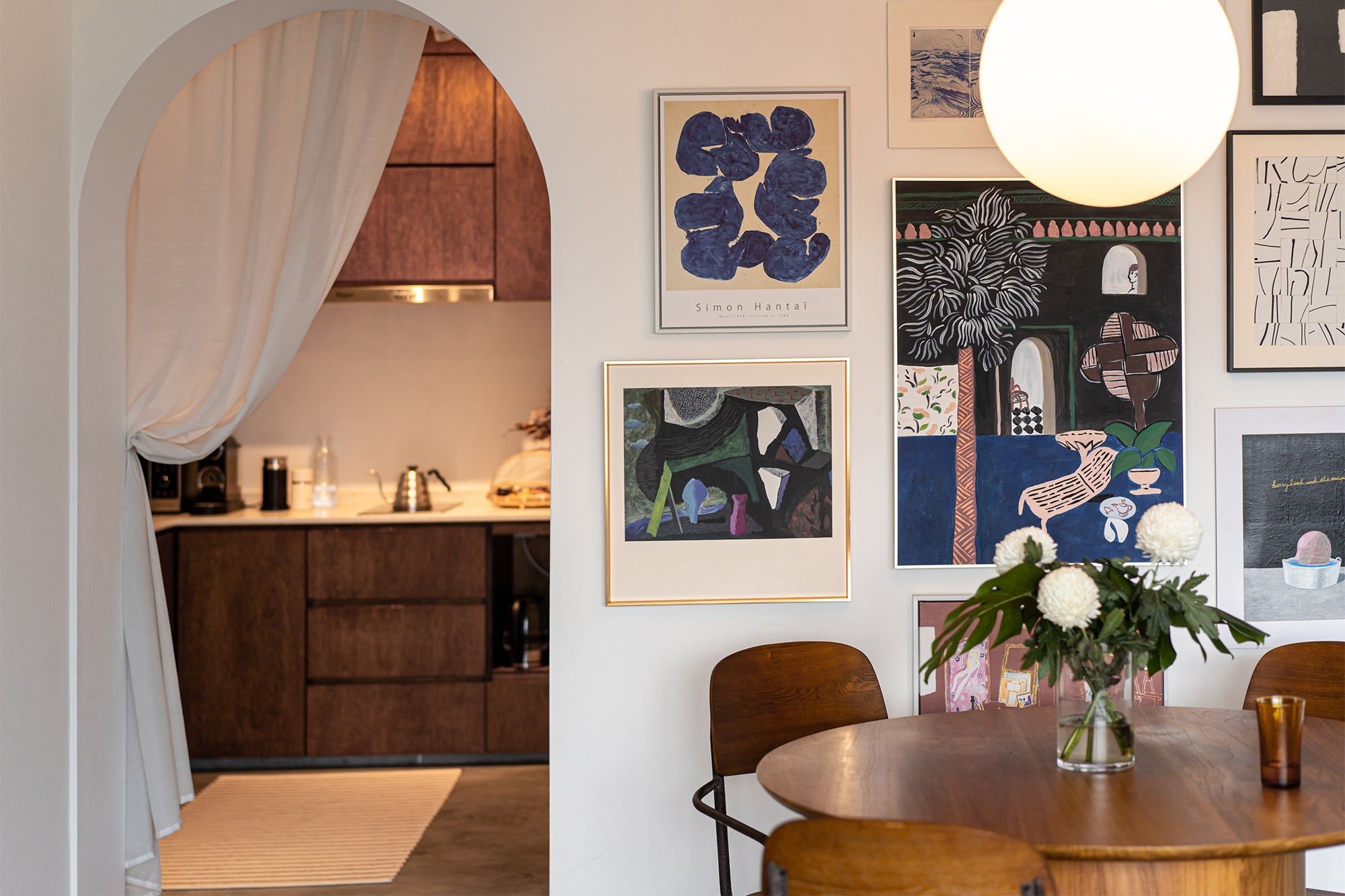 midcentury modern dining room with archway door