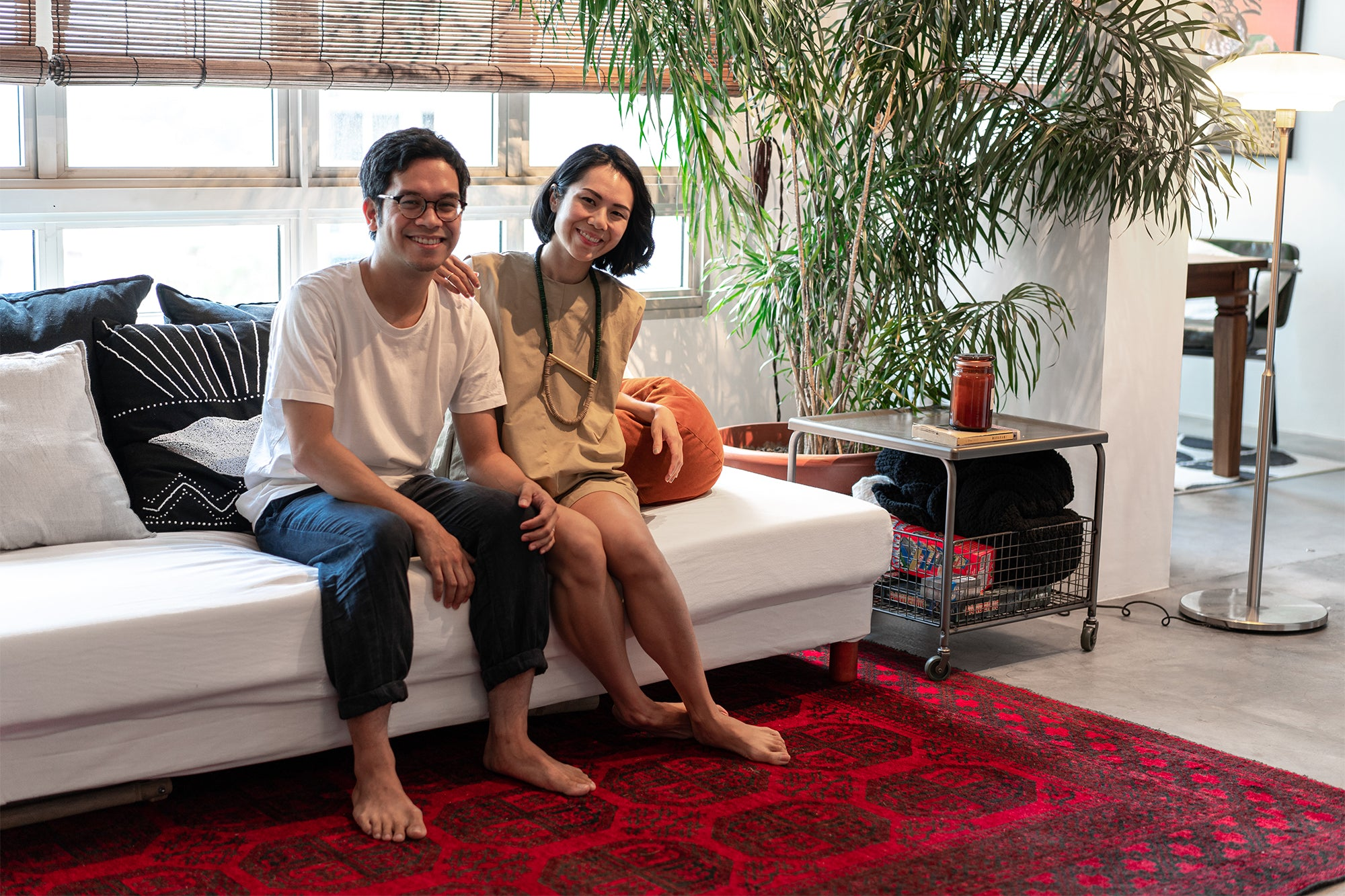 couple in midcentury modern home in singapore