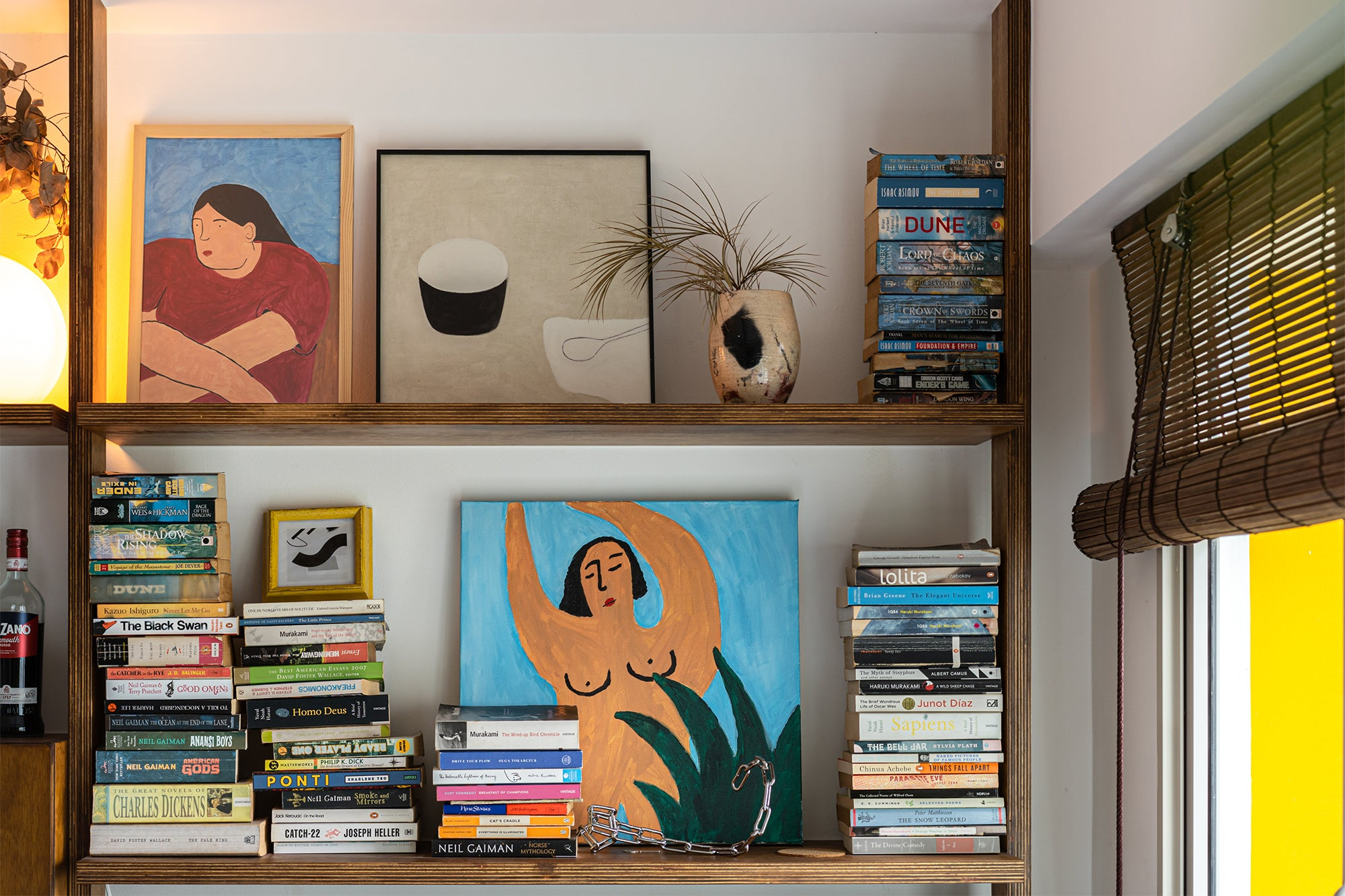 custom wooden shelf with books and paintings