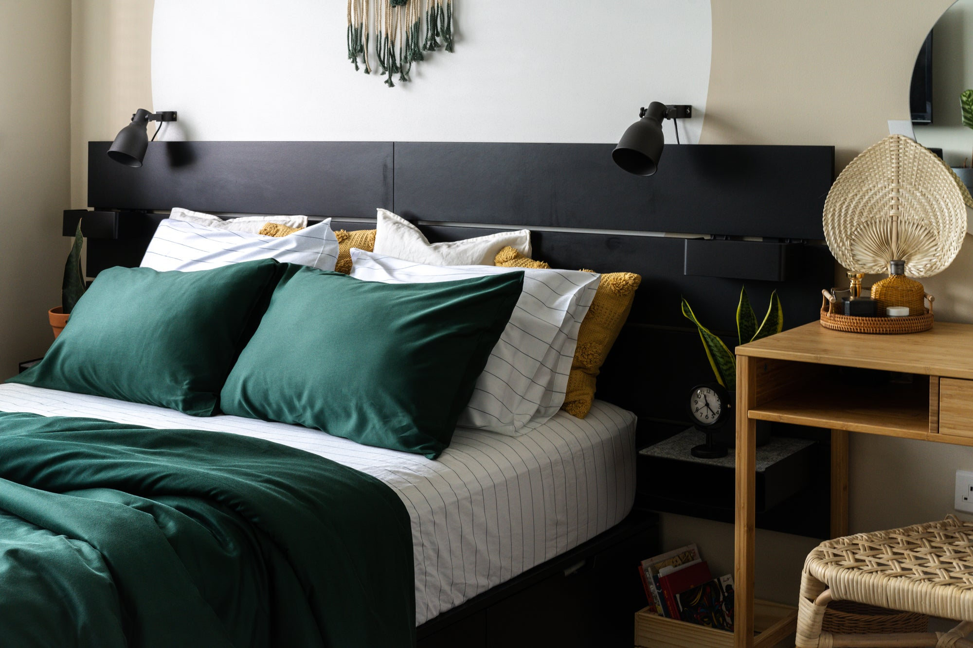 boho modern home with green and striped bedsheets