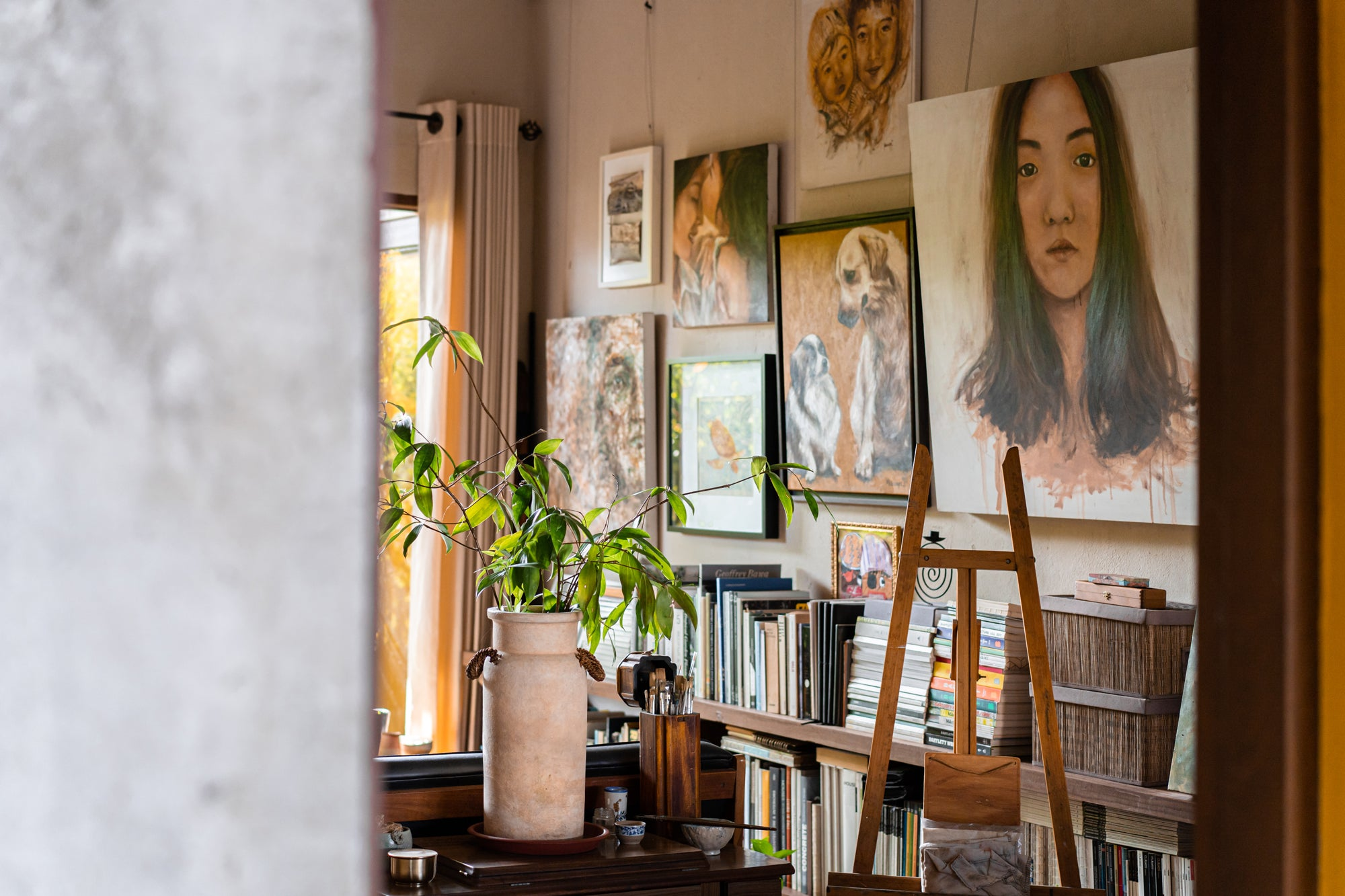 paintings hung up on room wall