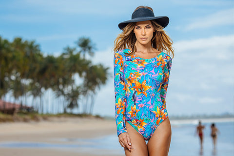 woman in the beach wearing long sleeve swimsuit and sun hat