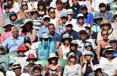 people wearing sun hats in the australia open