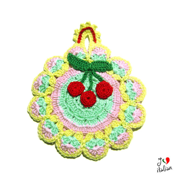 Colorful crochet potholder with Red cherries