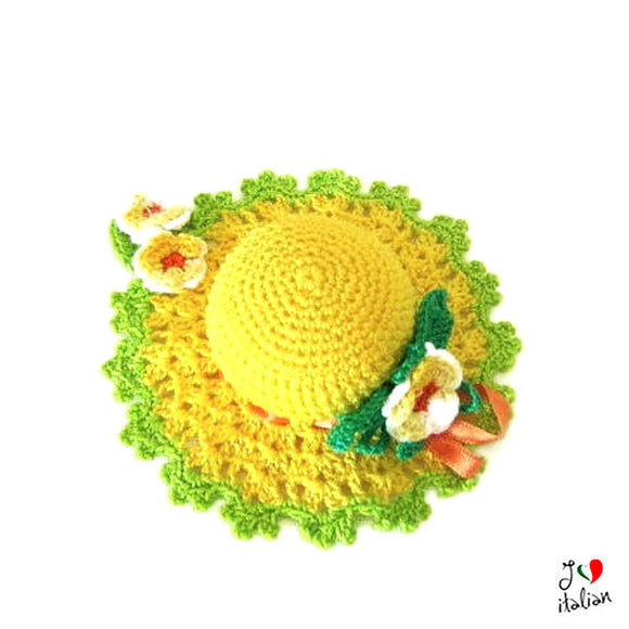 Yellow crochet hat pincushion with flowers