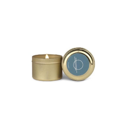 Saltwater and suede scented soy wax travel candle in 2 0z. tin