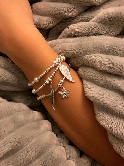 3 bracelet stack, cubic zirconia angel wing, antique feather and flower bracelet