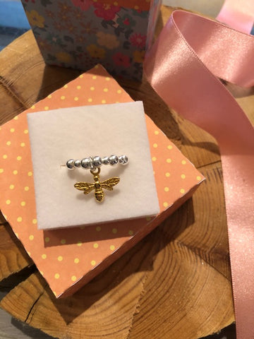 Gold bee charm with silver bead ring