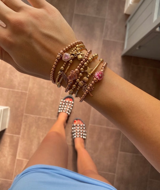 7 bracelet stack or gold and rose gold bracelets.
