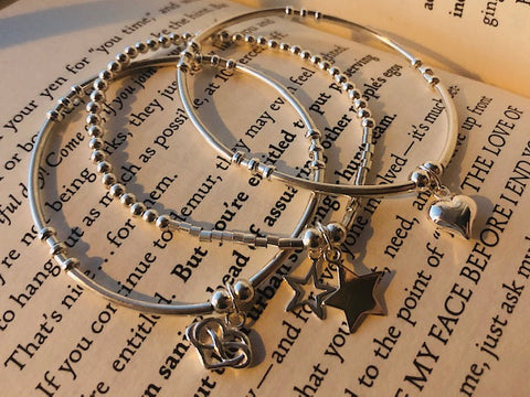 3 bracelet stack, sold heart, open and solid star, heart in hearts charm