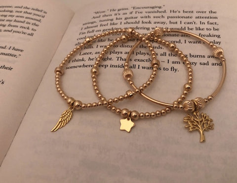 3 bracelet gold stack, feather, star and tree of life