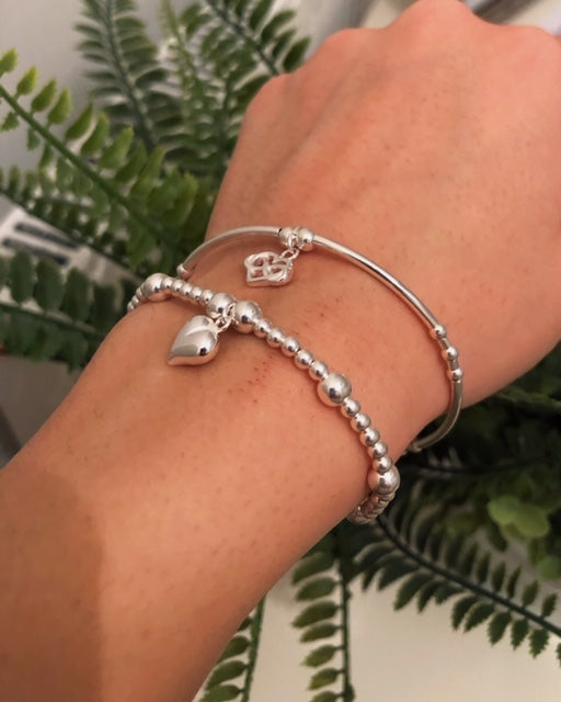 2 bracelet stack, solid heart and heart in hearts charm
