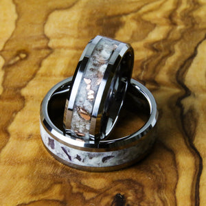 copper and amethyst wedding rings with tungsten band on wood background