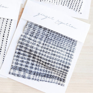 Handwoven cotton textile by the yard crafted by Ginger Sparrow, a modern home decor brand. Featuring grey and soft ivory checkered weave, it is light and airy, perfect for #throwpillows #drapes #livingroomdecor #bedroomideas