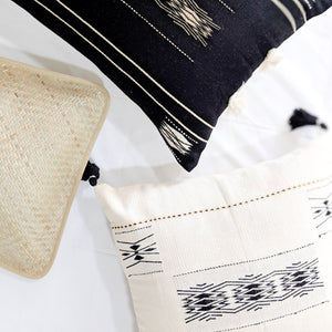 A soft ivory pillow in 18x18 inch size featuring traditional Indian tribal motifs. Handcrafted by Ginger Sparrow, a modern home decor brand. Perfect for #livingroomdesign and #bedroomdecorideas
