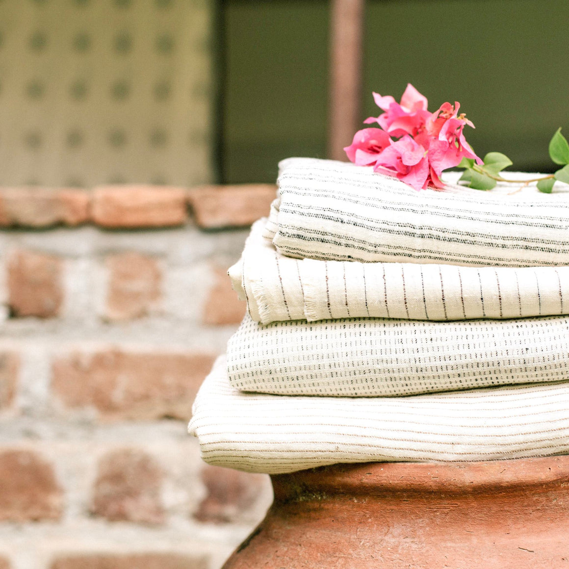 Handwoven cotton textile by Ginger Sparrow, a modern handcrafted home decor brand.  Featuring a soft ivory base with a black and ivory twisted yarn.