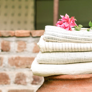 Handwoven Textile by Ginger Sparrow, a modern home decor brand. Featuring a terracotta hued step weave on a soft ivory ground. Light and airy its perfect for #throwpillows #drapes #livingroomdecor #bedroomideas