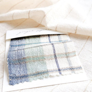 Handwoven Textile by Ginger Sparrow, a modern home decor brand. Featuring a soft ivory ground with a green and indigo striped weave. Light and airy its perfect for #windowshades #drapes #livingroomdecor #bedroomideas