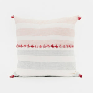 Throw pillow by Ginger Sparrow, a modern handcrafted home decor brand. The pillow features a soft ivory base with airy geometric lines in teal and terracotta and finished with a row of fluffy marsala red cotton tassels for some extra lush.