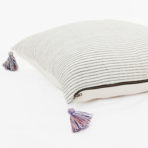 Throw pillow by Ginger Sparrow, a modern handcrafted home decor brand. Featuring a rich cream base with ticking stripes in black. Finished with fluffy cotton tassels for some extra lush.