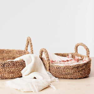 Banana Fiber baskets with a wide mouth and low profile. Perfect to stash linen, throws, books or toys.