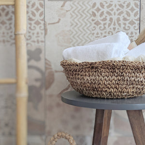 Detail view of a banana Fiber basket with a wide Mouth and low profile. Use as a shelf accent or store linen, towels, or flowers etc.
