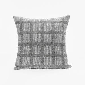 Throw pillow by Ginger Sparrow, a modern handcrafted home decor brand. The pillow features a soft grey base with airy checkered weave in white.