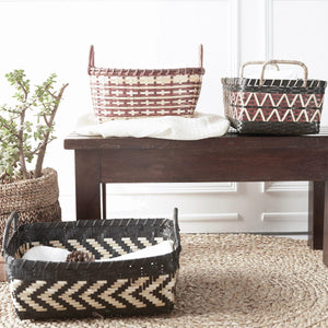 A set of 3 decorative storage baskets hand-made from bamboo grass. Meticulously crafted by artisans in the tribal villages of India. This nesting set makes perfect storage for pillows and a blanket beside the couch. You can buy them at Ginger Sparrow, an artisan made, global decor brand.