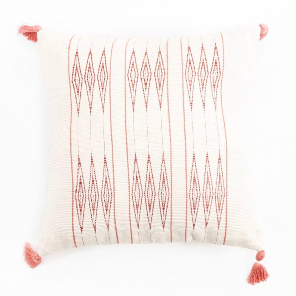 A soft ivory and coral pillow in 18x18 inch size featuring traditional Indian tribal motifs. Handcrafted by Ginger Sparrow, a modern home decor brand. Perfect for #livingroomdesign and #bedroomdecorideas