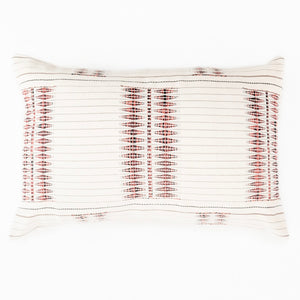 A soft ivory pillow in 16x24 inch size featuring traditional Indian tribal motifs in coral and indigo. Handcrafted by Ginger Sparrow, a modern home decor brand. Perfect for #livingroomdesign and #bedroomdecorideas