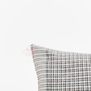 A soft ivory pillow in 18x18 inch size featuring a fawn and indigo checkered weave. Handcrafted by Ginger Sparrow, a modern home decor brand.