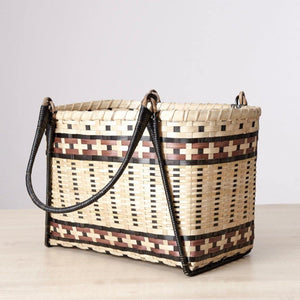 A roomy floor baskets made from bamboo grass. Meticulously handcrafted by artisans in the tribal villages of India. Perfect storage for pillows and a blanket beside the couch. You can buy them at Ginger Sparrow, an artisan made, global decor brand