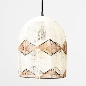Pendant lamp made using delicate cotton threads in soft ivory and brown.