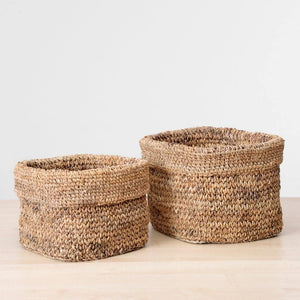 A collection of banana Fiber baskets stacked together. Perfect to hold plants. on a table or shelf. Use them also to stash linen in the closet