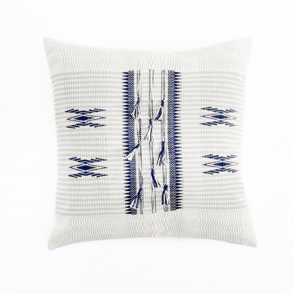 An 18x18 inch soft ivory and grey pillow featuring traditional Indian tribal motifs in indigo. Handcrafted by Ginger Sparrow, a modern home decor brand. Perfect for #livingroomdesign and #bedroomdecorideas