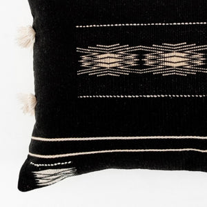 A soft black pillow in 16x24 inch size featuring traditional Indian tribal motifs. Handcrafted by Ginger Sparrow, a modern home decor brand. Perfect for #livingroomdesign and #bedroomdecorideas