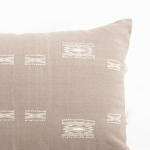 A neutral taupe pillow in 16x24 inch size featuring traditional Indian tribal motifs. Handcrafted by Ginger Sparrow, a modern home decor brand. Perfect for #livingroomdesign and #bedroomdecorideas