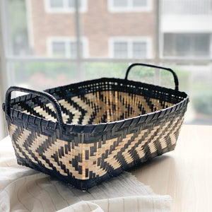 Bamboo storage organizers or gift baskets in an ivory and black palette. Handcrafted by Ginger Sparrow, an artisan made home decor brand. #giftbasket #holidaygiftideas #storagebasket