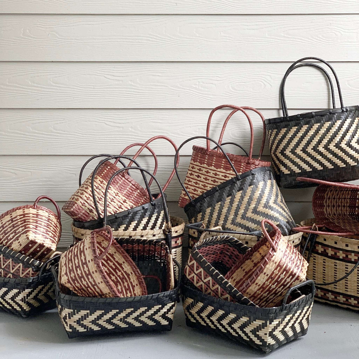 A handwoven bamboo decorative basket that doubles up as great storage organizers for the linen closet or laundry room. Also great as a decor accent for styling bedroom shelves. Crafted for Ginger Sparrow a modern artisan made home decor brand. #livignroomdecor #shelfie #shelfbasket #bedroomdesign