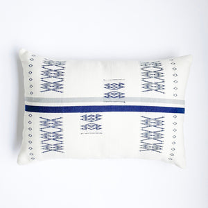 An 16x24 inch soft ivory and indigo pillow featuring traditional Indian tribal motifs. Handcrafted by Ginger Sparrow, a modern home decor brand. Perfect for #livingroomdesign and #bedroomdecorideas