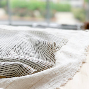Handwoven Textile by Ginger Sparrow, a modern home decor brand. Featuring black ticking stripes and finished with a gold zari trim on a soft ivory ground. Light and airy its perfect for #throwpillows #drapes #livingroomdecor #bedroomideas
