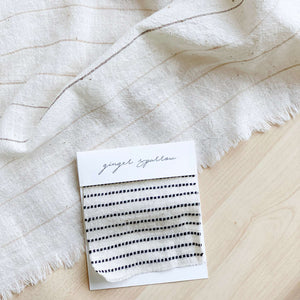 Handwoven Textile by Ginger Sparrow, a modern home decor brand. Featuring black ticking stripes on a soft ivory ground. Light and airy its perfect for #throwpillows #drapes #livingroomdecor #bedroomideas