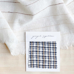 Handwoven Textile by Ginger Sparrow, a modern home decor brand. Featuring a fawn and indigo checkered weave. Light and airy its perfect for #throwpillows #drapes #livingroomdecor #bedroomideas