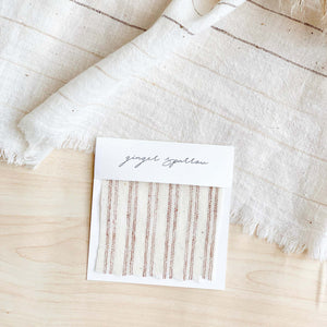 Handwoven cotton textile by Ginger Sparrow, a modern home decor brand. Featuring rugged stripes in earthy terracotta on a soft ivory ground. Light and airy its perfect for #throwpillows #drapes #livingroomdecor #bedroomideas
