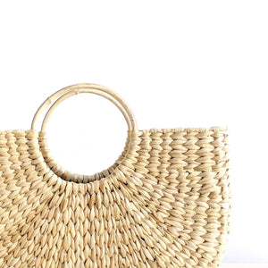 A water grass baskets featuring a striking arc silhouette. Shelf basket. Market basket, beach basket, basket bag. Spring vibe. Buttery Golden Hue.
