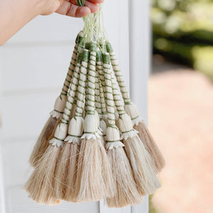 Handwoven palm leaf brush for light cleaning and dust cleaning around the house, great also as a shelf accent.