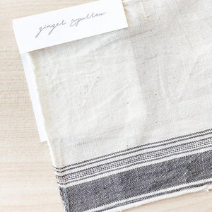 Handwoven Textile by Ginger Sparrow, a modern home decor brand. Featuring a charcoal edge stripe on an ivory base. Light and airy its perfect for #throwpillows #drapes #livingroomdecor #bedroomideas