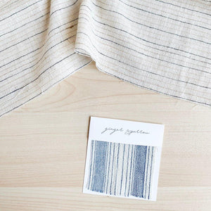 Handwoven Textile by Ginger Sparrow, a modern home decor brand. Featuring a blue thick stripe woven, light and airy its perfect for #throwpillows #drapes #livingroomdecor #bedroomideas